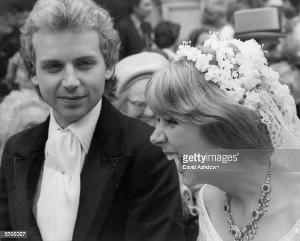 Actress Lady Marsha FitzalanHoward with actor Patrick Ryecart enjoying their wedding