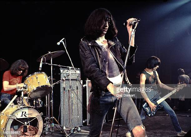 American punk band The Ramones perform live on stage at the Roundhouse in London on 4th July 1976. Left to right: Tommy Ramone Joey Ramone and Dee...