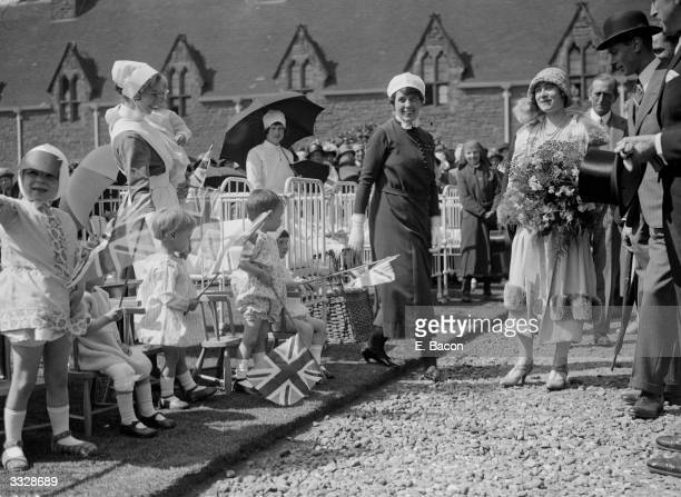 Future King and Queen George Duke of York and Elizabeth Duchess of York being greeted by child patients in the grounds of The Guest Hospital in...