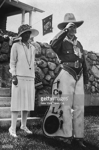 American president Calvin Coolidge and his wife First Lady Grace Coolidge pose outdoors at a party celebrating the 4th of July and his 55th birthday...