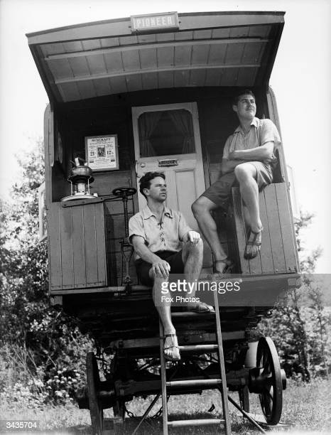 A couple sitting in the 'back porch' of their motor caravan at St Albans in Hertfordshire
