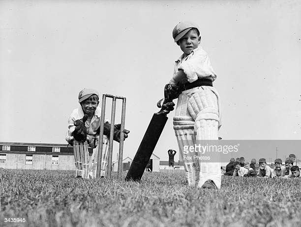 Two little boys take their cricket very seriously at Dymchurch Kent