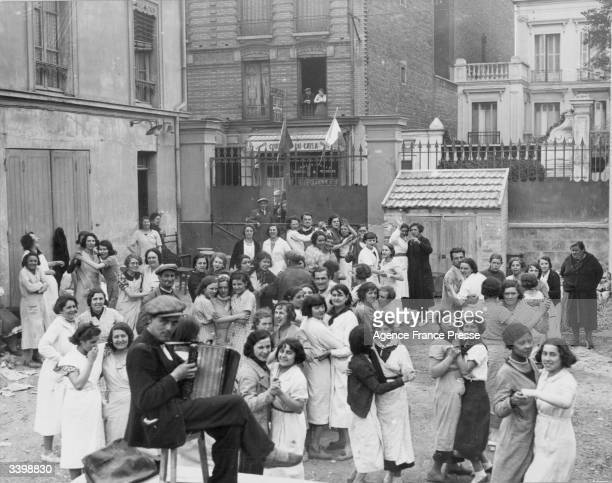 French striking factory workers dancing to classical music in the courtyard of their factory in Paris
