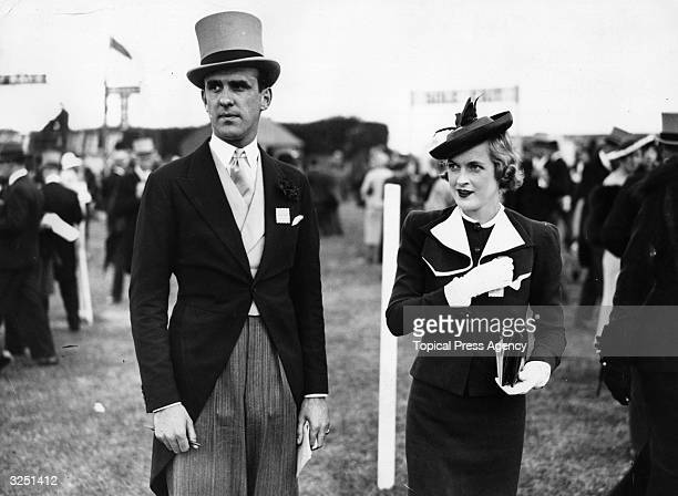 Striking hat fashion, worn by a woman visitor at Epsom race-course.