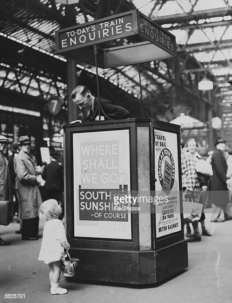 A little girl at Waterloo Station makes enquiries for trains to the seaside during the Whitsun Holidays