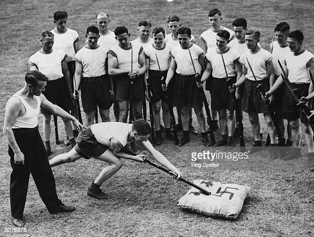 J K Hassell Welsh Amateur International goalkeeper for Wales at bayonet practice in front of new recruits one of many sportsmen who have joined the...