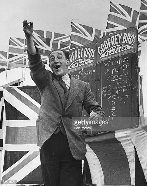 A cheerful bookmaker shouting out odds at Epsom Racecourse during the first Derby since the oubreak of World War II