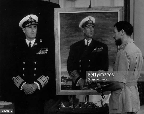 Bernard Hailstone an official naval war artist painting a three quarter length portrait of Lord Louis Mountbatten