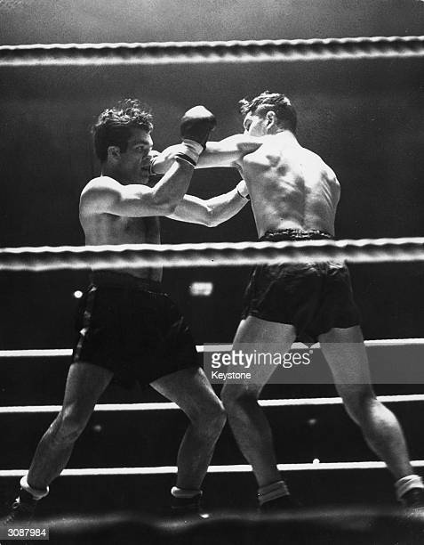 In a boxing match at Harringay London Bruce Woodcock misses with a left handed punch to Freddie Mills's face He went on to outpoint Mills in a...