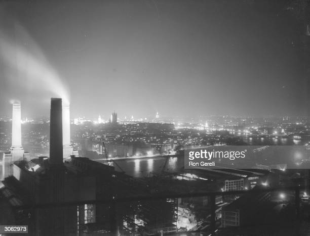 London at night with the Battersea power station in the foreground.