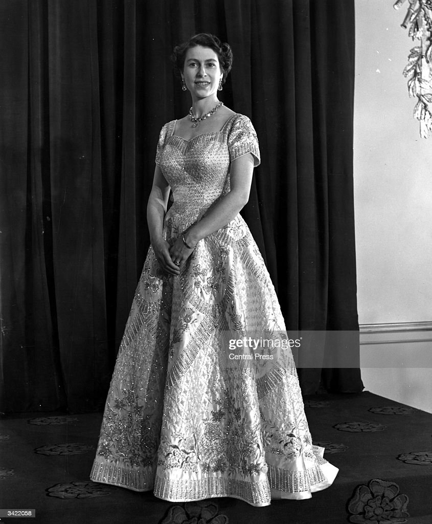 Queen Elizabeth II wearing a gown designed by Norman Hartnell for her Coronation ceremony.