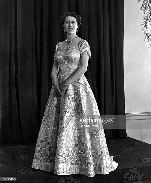 Queen Elizabeth II wearing a gown designed by Norman Hartnell for her Coronation ceremony