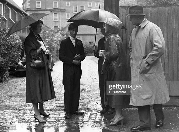 Prince Michael of Kent with Princess Alexandra Prince William of Gloucester the Duchess of Gloucester and the Duke of Gloucester standing in the rain