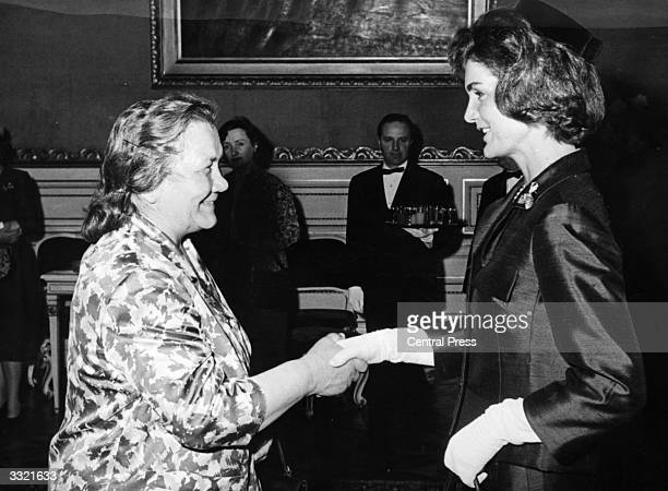 Nina Khrushchev the wife of Soviet politician Nikita Khrushchev shakes hands with Jackie Kennedy the wife of American president John F Kennedy at the...