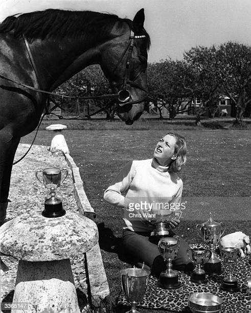 'Stroller' watches Marion Coakes Britain's top female show jumper polishing her trophies on the lawn of her home at New MiltononSea
