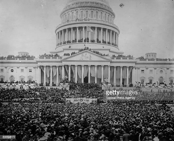 Crowds gathered outside The Capitol building in Washington D.C for the inauguration of President Woodrow Wilson, the 28th President of the United...