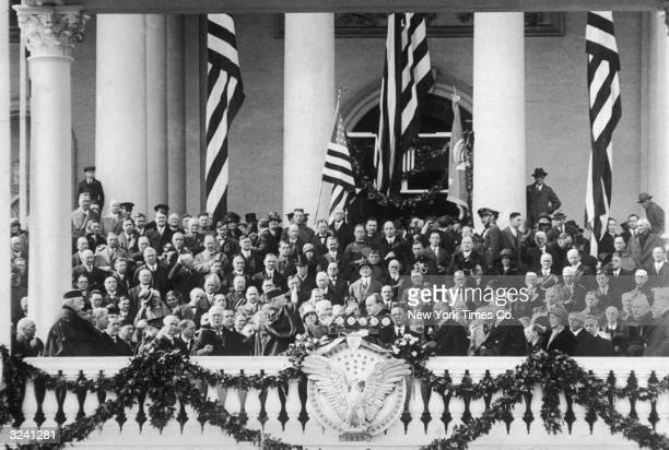 American president Calvin Coolidge takes the oath of office at his Inauguration ceremony, Washington, DC. William Howard Taft, Supreme Court Justice...