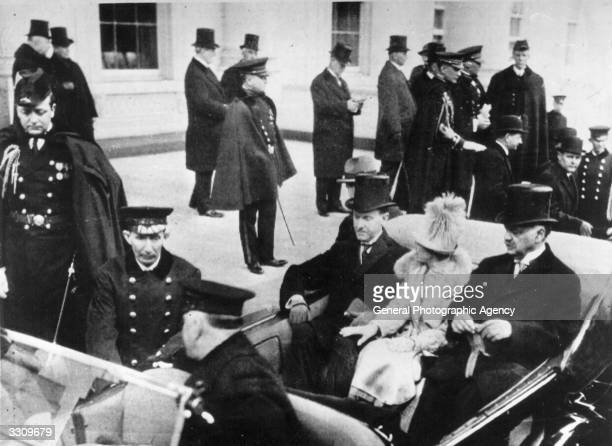 American President Calvin Coolidge leaving the White House with his wife Grace and Senator Charles Curtis, chairman of the Inaugural Committee, for...