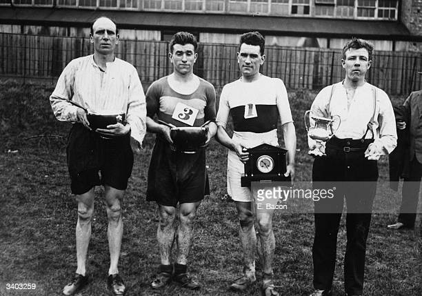 New Cross Fire Brigade the winning team of the Fire Brigade cross country championship at North Finchley London Left to right Mills Tabbs Frampton...