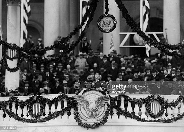 President Herbert Hoover delivering his inaugural speech to the thousands assembled before the National Capitol in Washington DC.