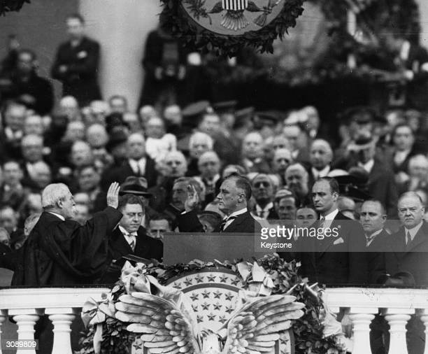 President Franklin Delano Roosevelt takes the oath of office as 32nd president of the USA Chief Justice Charles E Hughes administers the oath as...