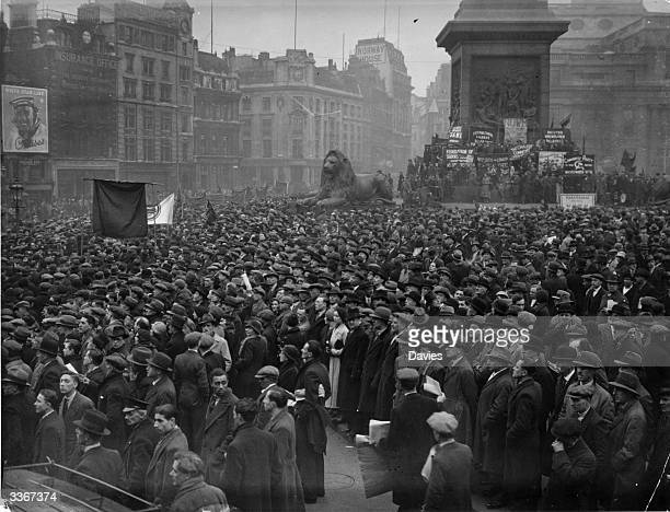 Crowds of unemployed people gather for a mass meeting in London's Trafalgar Square.