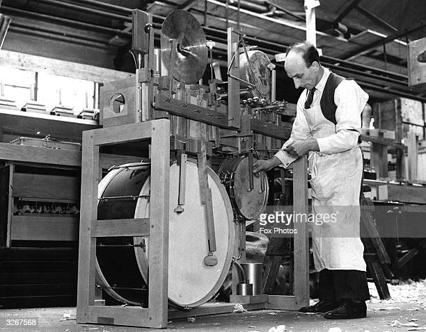 A man fits up the 'jazz' or percussion section of a modern organ at John Compton's organ factory at North Acton The sounds of almost every instrument...