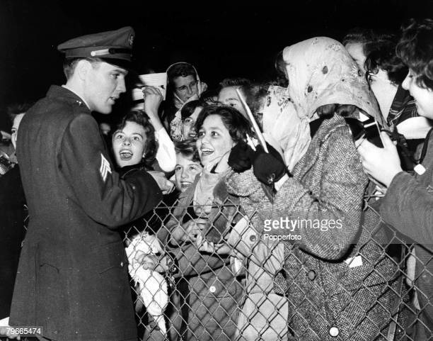 4th March 1960 Prestwick Scotland Sergeant Elvis Presley American rock and roll singer meets some of his screaming teenage fans who are there to...