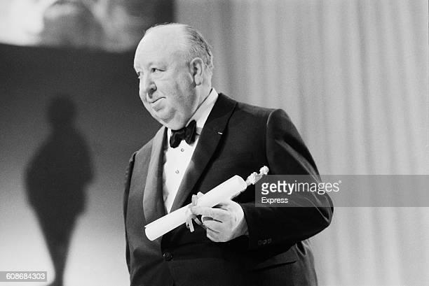 British-born film director Alfred Hitchcock wins the BAFTA Academy Fellowship Award at the Society of Film and Television Arts Awards at the Royal...