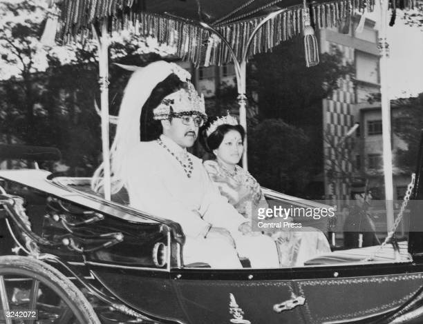 King Birendra and Queen Aishwarya of Nepal ride their ceremonial carriage following their coronation ceremony in Katmandu