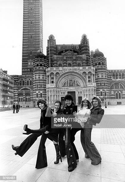 Pop singer Alvin Stardust centre with members of the singing dance troupe 'Guys And Dolls' outside Westminster Cathedral London where they have been...