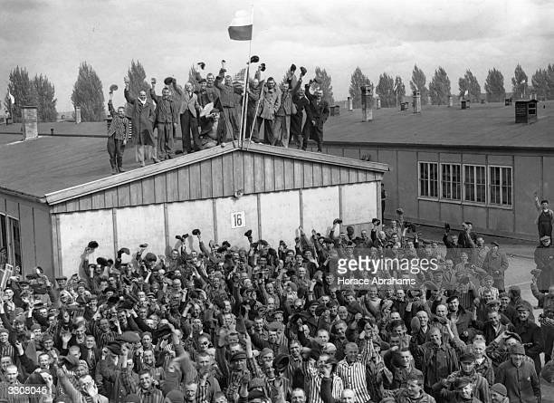 Prisoners at Dachau the infamous concentration camp celebrate their liberation following the arrival of the men of the 42nd Rainbow Division of the...