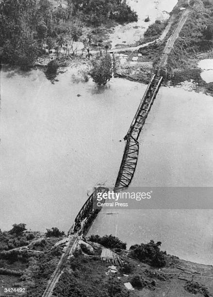 The middle span of a bridge on the Bangkok Railway lies in the river after being bombed by the RAF.