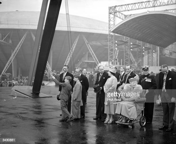 Queen Elizabeth consort to King George VI with Queen Mary and British Labour politician Herbert Morrison at the Festival of Britain Exhibition on...