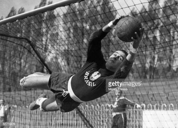 Gilmar the goalkeeper for Brazil's national team saves a goal during a training session at Dulwich Hamlet's ground in south London before a...