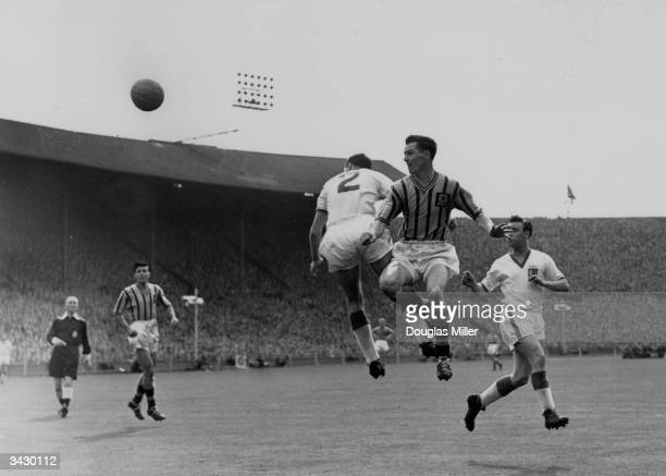 Aston Villa footballer Peter McParland heading towards goal during the FA Cup final against Manchester United