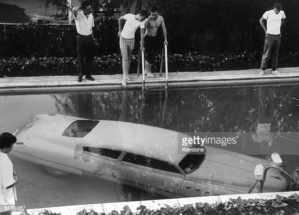 A submerged car which its drunken owner 'parked' in a swimming pool in Beverly Hills California believing it to be a parking space Nobody was injured...