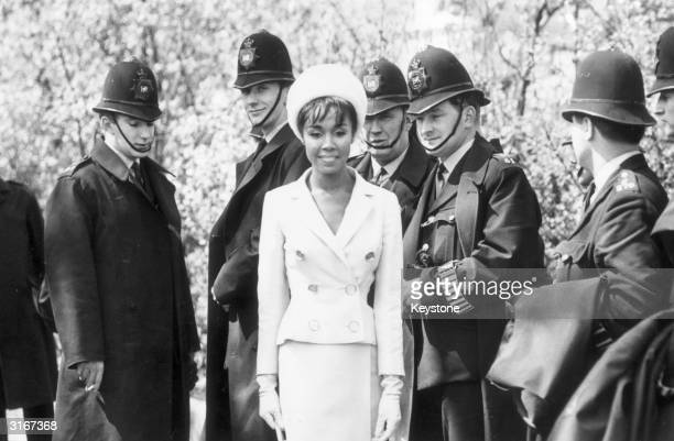 A group of policemen preparing to go on duty for the London May Day Rally at Trafalgar Square are diverted from their duties by the American jazz...