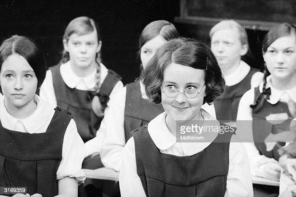 British actress Olivia Hussey plays a schoolgirl in the stage play 'The Prime of Miss Jean Brodie' at the Wyndham Theatre