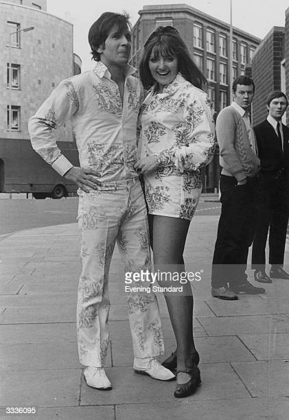 A couple Peter Memphis and Sue Reynolds wearing matching 'his and hers' shirts He is wearing trousers made of the same patterned material