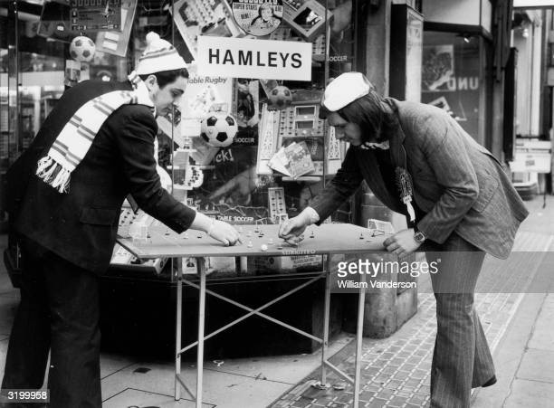 Colin Lewis and Gerard Brierley killing time before the Cup Final at Wembley between Leeds and Sunderland with a pre match Game of Subbuteo Table...