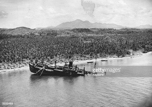 Japanese transport ship with its wrecked stern resting on the bottom of the beach at Guadalcanal.