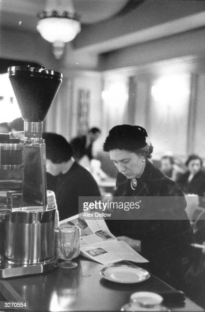 A woman reading in the Lindy Lou coffee bar Kensington London Original Publication Picture Post 8628 Coffee Bars unpub