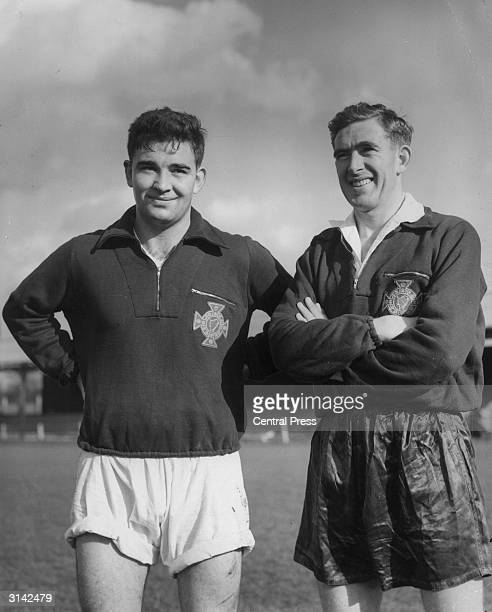 Jackie Blanchflower of Manchester United with his brother Danny of Spurs at Hendon where they were training with the Ireland team for their match...