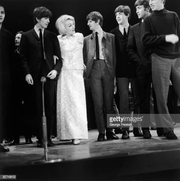 German born American actress Marlene Dietrich with British pop group The Beatles from left to right George Harrison Ringo Starr Paul McCartney and...