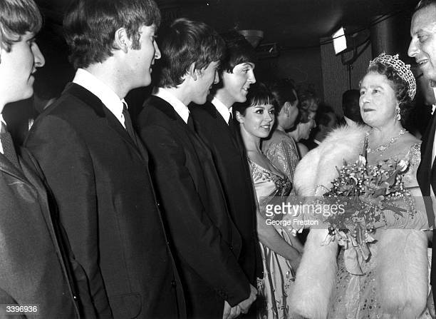 Queen Elizabeth The Queen Mother talking to British pop group The Beatles after a Royal Variety Show at the Prince of Wales Theatre London