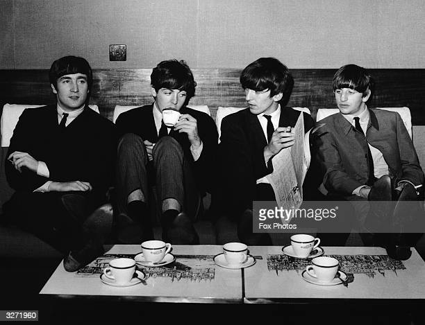 The Beatles take a break from their rehearsals for the Royal Variety Performance at the Prince of Wales Theatre with a coffee after lunch at the...