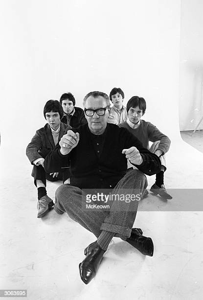 The Small Faces, a popular English Mod band of the late 1960s with their manager Bill Corbett.