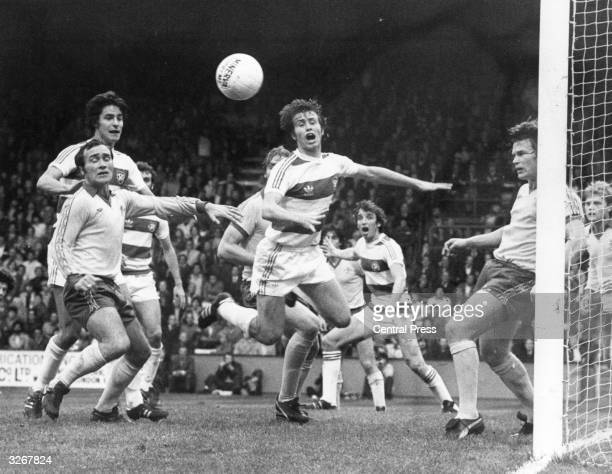 The match between Queens Park Rangers and Chelsea at Loftus Road David Stride of Chelsea knees away a corner with Peter Eastoe of QPR Ron Harris of...