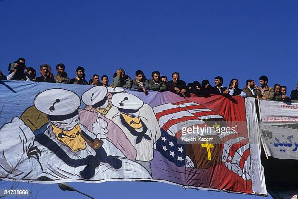 Demonstrators gather on a pedestrian bridge in Tehran to commemorate the anniversary of the occupation of the US embassy in Tehran on November 4th...